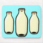 Botellas de leche superiores del oro alfombrillas de ratón