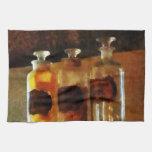 Botellas del boticario toallas de cocina
