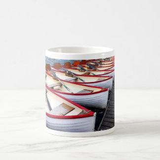 Botes de remos taza de café