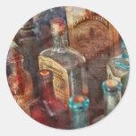 Boticario - una serie de botellas etiqueta redonda