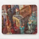 Boticario - una serie de botellas tapete de ratones