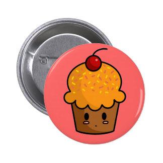 Botón anaranjado de la magdalena pin