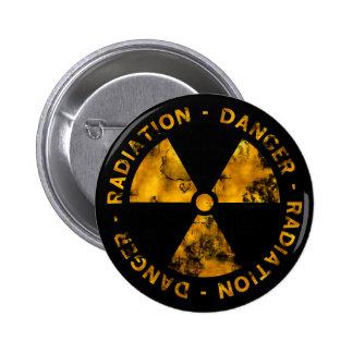 Botón apenado del símbolo de la radiación pin