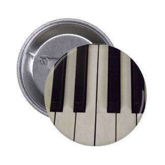 Botón blanco y negro de las llaves pin