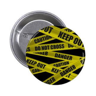 Botón de la cinta de la precaución pins