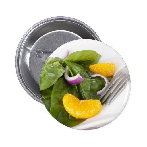 Botón de la ensalada del mandarín de la espinaca pins