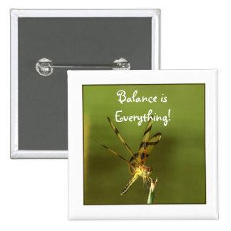 Botón de la foto de la balanza de la libélula