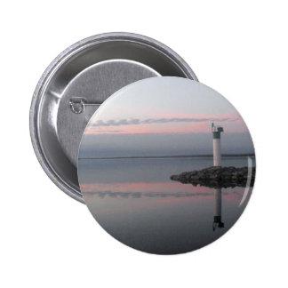 Botón de las reflexiones del faro pin