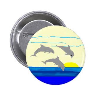 Botón de salto de los delfínes de la puesta del so