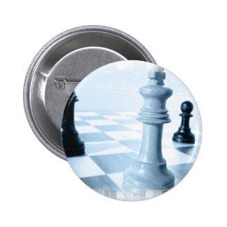 Botón del diseño del ajedrez pins