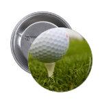 Botón del diseño del tee de golf pins