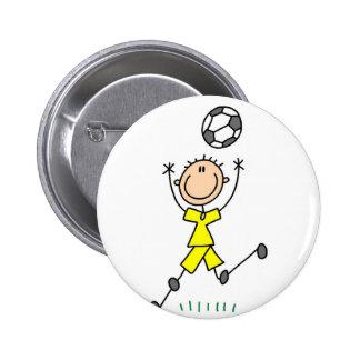 Botón del jugador de fútbol del muchacho pins