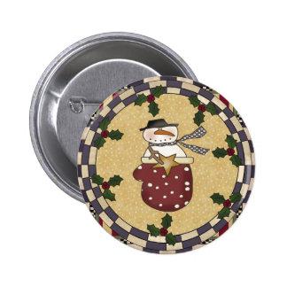 Botón del navidad - muñeco de nieve en una manopla