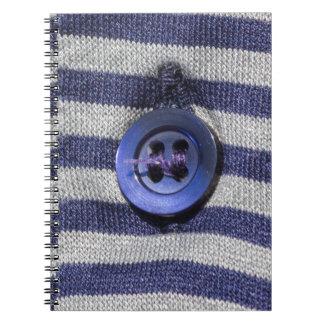 botón en la camisa cuaderno
