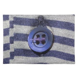 botón en la camisa mantel