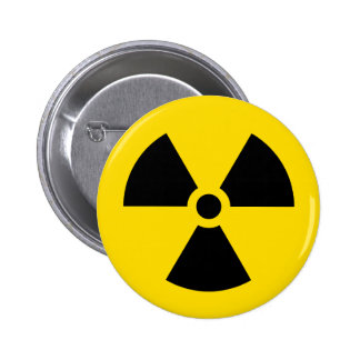 Botón negro y amarillo del símbolo de la radiación pin