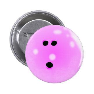 Botón (rosado) de la bola de bolos