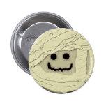 Botón sonriente de la momia pins