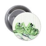 Botón verde del bolso y de los zapatos pins