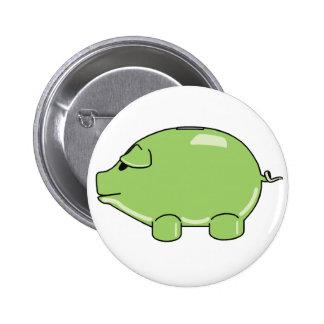 Botón verde del cerdo pins