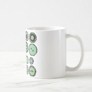 botones verdes taza de café