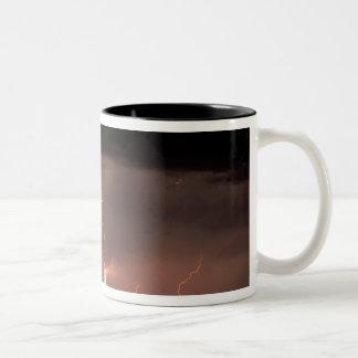 Botswana, Moremi Game Reserve, Lightning fills Coffee Mug