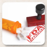 Bottle of Pills and a FDA APPROVED rubber stamp Beverage Coaster
