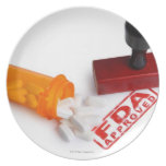 Bottle of Pills and a FDA APPROVED rubber stamp Dinner Plate