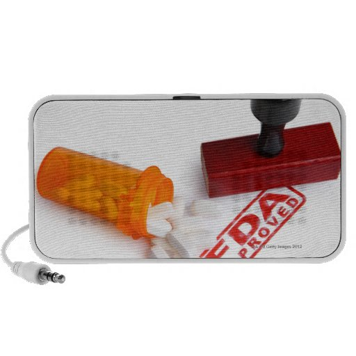 Bottle of Pills and a FDA APPROVED rubber stamp Travelling Speakers