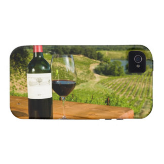 Bottle of red wine and glass on table vibe iPhone 4 case