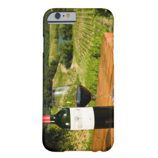 Bottle of red wine and glass on table barely there iPhone 6 case