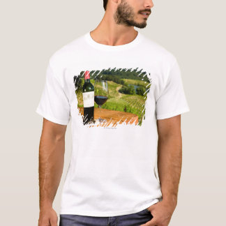 Bottle of red wine and glass on table T-Shirt