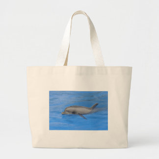 Bottlenose dolphin swimming large tote bag