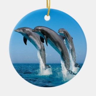 bottlenose dolphins jumping out of clear blue sea ceramic ornament