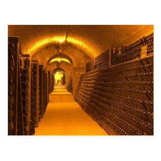 Bottles aging either in pupitres (racks) waiting postcard