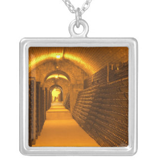 Bottles aging either in pupitres (racks) waiting square pendant necklace