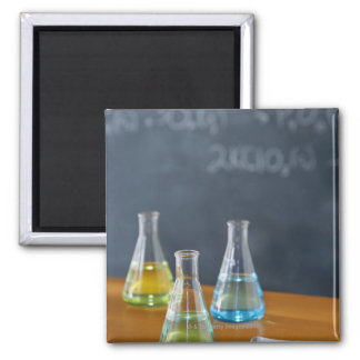 Bottles arranged for science experiment 2 inch square magnet