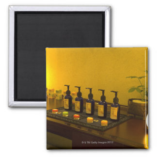 Bottles of aromatherapy oil in the beauty salon, 2 inch square magnet
