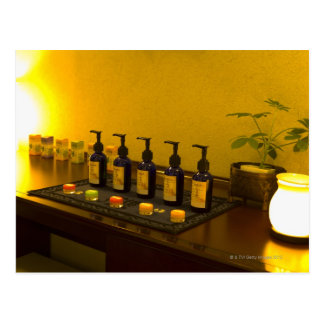 Bottles of aromatherapy oil in the beauty salon, postcard