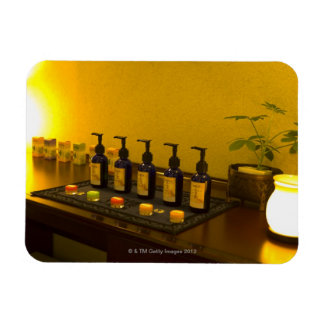 Bottles of aromatherapy oil in the beauty salon, rectangular photo magnet