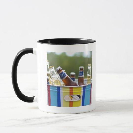 Bottles of beer in ice bucket mug