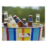 Bottles of beer in ice bucket poster