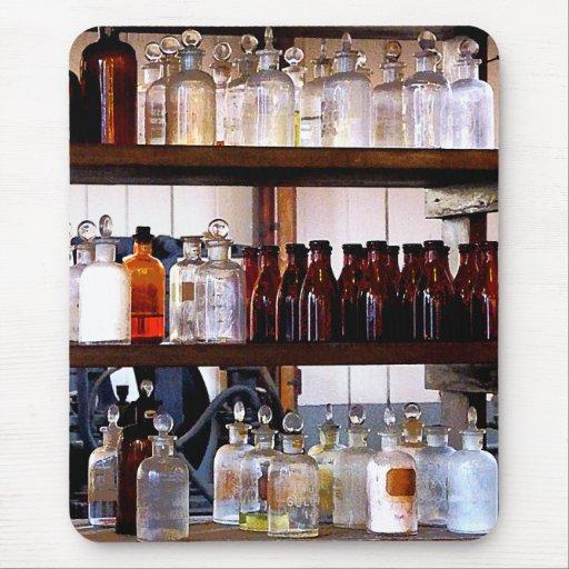 Bottles of Chemicals on Shelves Mousepads