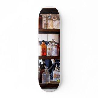 Bottles of Chemicals on Shelves skateboard