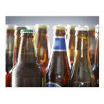 Bottles of various bottled beer in studio postcard