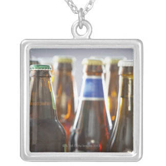 Bottles of various bottled beer in studio silver plated necklace