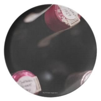 Bottles of wine, close-up, Sweden. Melamine Plate