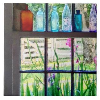 Bottles on Kitchen Window Tile