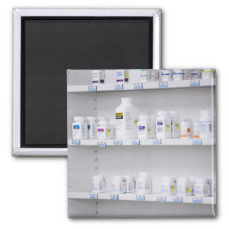 bottles on the shelves at a pharmacy 2 inch square magnet