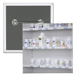 bottles on the shelves at a pharmacy button